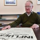 Public health researcher Warwick Brunton with an original public health warning poster produced...