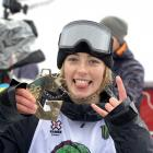 Zoi Sadowski-Synnott with her gold medal after winning the snowboard slopestyle at the X Games in...