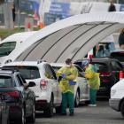 Medical personnel administer tests for coronavirus at the Bondi Beach drive-through testing...