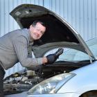 AA Auto Centre Dunedin service manager Shaun Fairbairn checks a car battery to make sure it is...