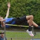Over he goes . . . Invercargill athlete Quinn Hartley clears the bar to win the boys grade 14...