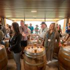 Otago Daily Times wine columnist Mark Henderson (centre left in checked shirt) at the Pinot Noir...