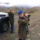 George (10) and Ben (9) Williamson check out what is happening on Glenbrook Station. PHOTO: SUPPLIED