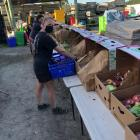 Loading up . . . The team at Grown, of Sefton, are busy packing up boxes of vegetables for home...
