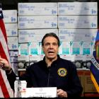 New York Governor Andrew Cuomo speaks in front of stacks of medical protective supplies during a...