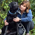 Dunedin resident Frankie Vella, who rescued her black Labrador, Finn, from a leg hold trap set by...