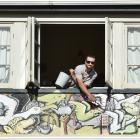 Enrico Cornuda, a backpacker and artist from Italy, has been painting a mural on the outside of...