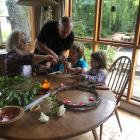 Family commemoration: John and Juliet den Heuval work with their children, Noah and Mila, on...