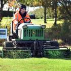 Island Park greenkeeper Michael Minty gets to work on the 17th tee at Island Park yesterday.PHOTO...