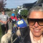 Tactix coach Marianne Delaney-Hoshek on a walk with husband Mike, sons Zac and Sam, and dog...
