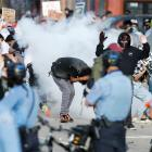 Police used tear gas, plastic bullets and concussion grenades to keep the crowds at bay, while...