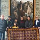 Yama Nabi presented a handmade rug to The Rees Hotel. His family are pictured with manager Mark...