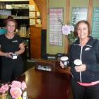 Sticking to contactless takeaway rules are Nosh staff member Kelsey Greer (left) and cafe regular...