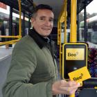 Otago Regional Council public transport team leader Julian Phillips shows off the new tag on-tag...
