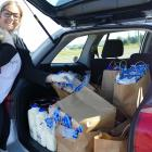 Oranga Tamariki children's social worker Nikita Hames makes a delivery of essential groceries to...