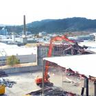 A digger brings down part of the former Cadbury warehouse in Dunedin yesterday, as work picks up...