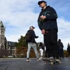 New traffic and parking regulations require  e-scooter and skateboard users and cyclists to walk...