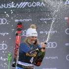Champagne moment ... Queenstown teenager Alice Robinson celebrates after winning the giant slalom...