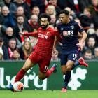 Mohamed Salah of Liverpool competing with Junior Stanislas of AFC Bournemouth for the ball in...
