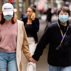 People wearing face masks walk along Swanston St in Melbourne, as more retail stores reopen their...