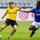 Lukasz Piszczek (left) of Borussia Dortmund is challenged by Rabbi Matondo of FC Schalke 04  on...
