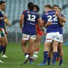 Warriors players celebrate their victory over the Dragons at Central Coast Stadium in Gosford....