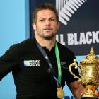 Richie McCaw carries the Webb Ellis Cup into the post-match press conference after the 2015 Rugby...