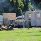 Fire and Emergency New Zealand and police are continuing their investigation into a house fire in...
