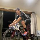 Wanaka multisport athlete Braden Currie races in a virtual race in his home in Wanaka yesterday...