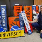 Constable Scott McMurtrie with stolen street signs mostly recovered from student flats around...