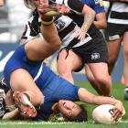 Otago Spirit second five-eighth Kilisitina Moata'ane places the ball to score as Hawke's Bay No8...