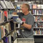 Unlocked, stocked and borrowed ... Dunedin City Library assistant Ian Woodford replenishes the...