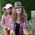 Michelle Cox and Hayley (6) with the different ingredients needed for a compost heap. PHOTOS:...