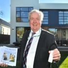 Edinburgh Realty property consultant Jim Columb prepares to show potential buyers through an open...