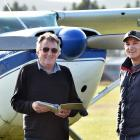 Otago Aero Club chief flying instructor John Penno (left) renews Air New Zealand pilot Jonny...