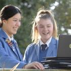Screen time ... Queen's High School deputy head girl Maisy Costa (left) and head girl Sophie...