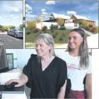 Melissa (left) and Della-May Vining look over concept plans for the Southland Charity Hospital....