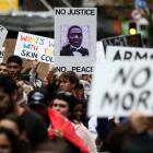 Protesters march down Auckland's Queen St on Sunday in solidarity with protests across the United...