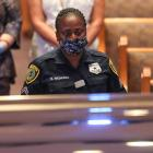 A Houston police officer views George Floyd's casket during the memorial. Photo: Reuters