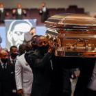 Pallbearers carry George Floyd's casket out of The Fountain of Praise church in Houston. Photo:...