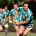 All Black first five-eighth Dan Carter trains at the So Kon Po sports ground in Hong Kong in...