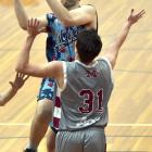 Magic Lions player James Scobie pops a shot over the head of Magic A player Joe Ahie during a...