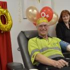 Doug Armishaw, of Dunedin, donated blood for the 350th time, supported by donor technician Vicki...