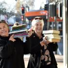 Regent Theatre 24-hour Book Sale co-ordinator Alison Cunningham (left) and Dunedin Central Rotary...