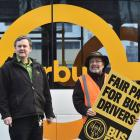 Tramways Union members Raymond Tonkin (left) and Peter Dowden at the bus hub in Great King St, in...