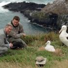 Prince Charles and then head ranger at the Royal Albatross Centre, Lyndon Perriman, look at a...