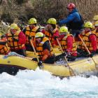 Upper Clutha essential workers plough through ''the wave'' on the Hawea River. PHOTO: MARK PRICE