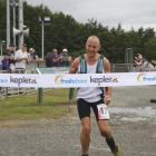IMG 3571: Dwight Grieve, Fiordland Athletics Club Captain and Te Anau police officer Dwight...