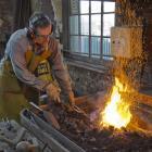 Blacksmithing teacher Kelly Gragg heats metal to more than 1000degC at the Dunedin Gasworks...