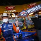 Scott Dixon celebrates in Victory Lane after winning the NTT IndyCar Series - Genesys 300 at...